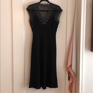 Gorgeous black dress with mesh detail. Size 8